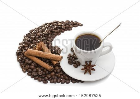 white cup of coffee and coffee beans isolated on white background with cinnamon sticks, anise and chocolate
