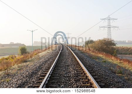 railway disappearing into the distance along the field
