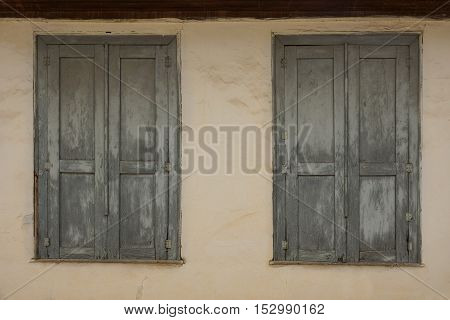Old, wooden, closed casement windows of old house