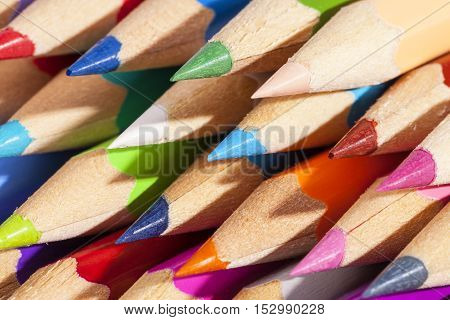 Background of chipped colored crayons close up