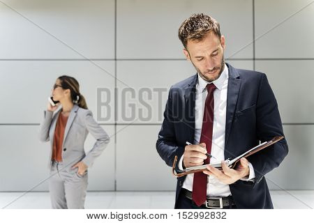 Business People Mobile Writing Notebook Report Concept