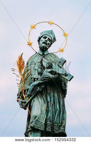 The statue of St. John of Nepomuk on Charles bridge in Prague, Czech Republic