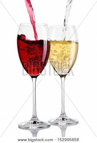 Glass of red and white wine pouring from bottle on white background