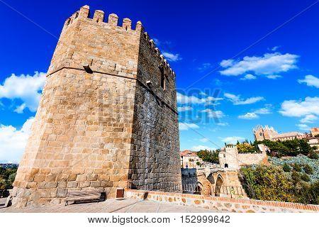 Toledo Spain. San Martin stone bridge across calm river. Popular tourist place in Europe.