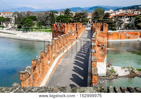 Verona Italy. Medieval bridge of Ponte Scaligero built over Adige River Castelvecchio.