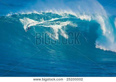 MAUI, HI - MARCH 13: Professional surfer Archie Kalepa rides a giant wave at the legendary big wave surf break known as