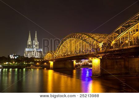 Cologne Cathedral and Hohenzollern Bridge at night Cologne (Koeln), Germany