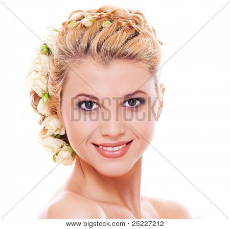 portrait of pretty smiley model with roses in hair. isolated on white background
