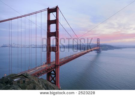 Golden Gate Brige With Sunset Colors In The Background