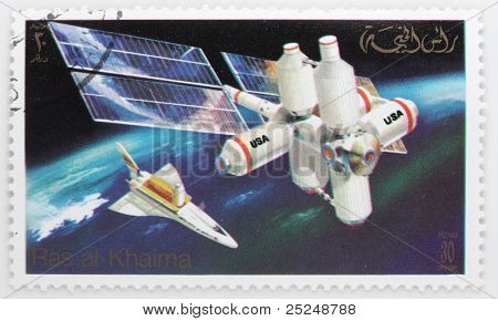 RAS AL KHAIMA - CIRCA 1982: A stamp printed in The Ras Al Khaima shows The Space Shuttle with Space Station over a Earth, circa 1982.