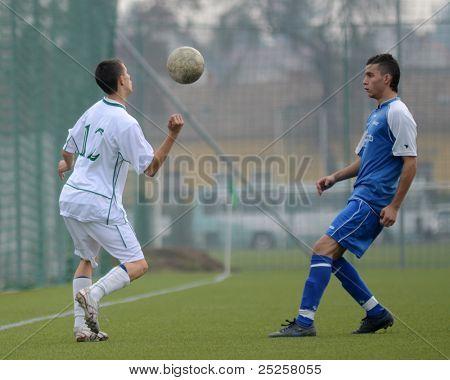 KAPOSVAR, HUNGARY - NOVEMBER 6: Krisztian Keresztes (L) in action at the Hungarian National Championship under 19 game Kaposvar vs. Nagybajom November 6, 2011 in Kaposvar, Hungary.