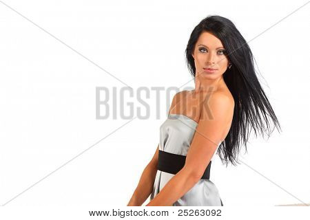 beautiful smart woman with flowing hair looks mysteriously isolated on white