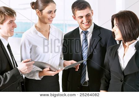 Business people in suit watching documents