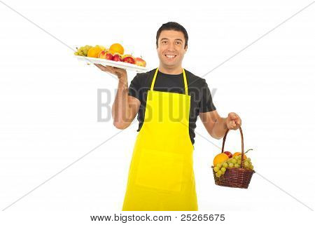 Greengrocer Holding Plateau And Basket With Fruits
