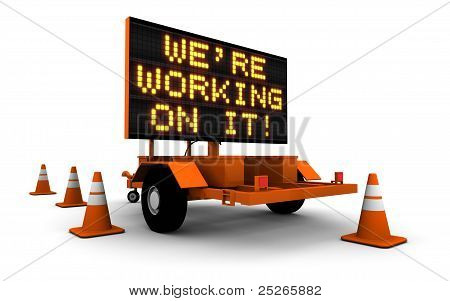 We're Working On It! - Construction Sign