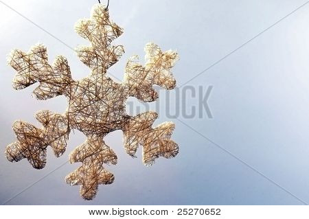 Snowflake made of straws as christmas tree decoration