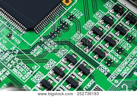 Macro Shot Of A Circuitboard With Resistors Microchips And Electronic  Components  Computer Hardware poster
