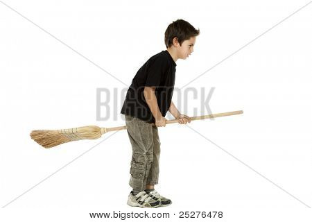 portrait of little boy with a broom, side view on white background