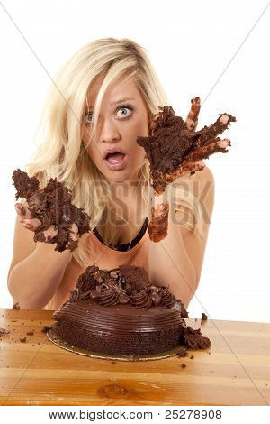 Woman With Hands Full Of Cake