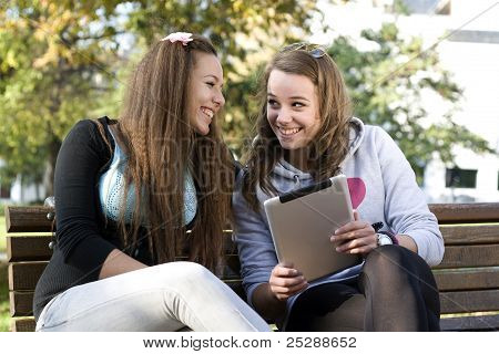 Two Young Girls With Tablet Pc