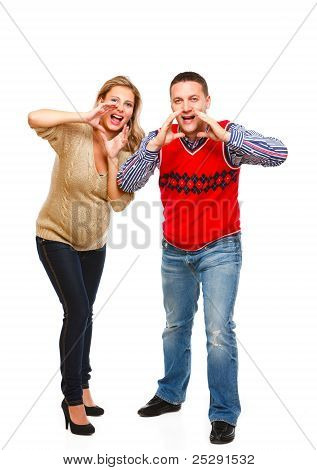 Young Pregnant Woman With Husband Shouting Through Megaphone Shaped Hand On White Background