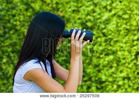 woman with binoculars looking to the future