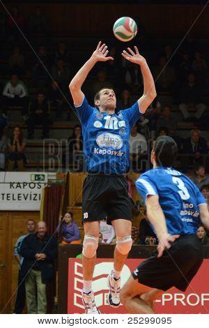 KAPOSVAR, HUNGARY - NOVEMBER 13: Tamas Kaszap (10) in action at a Hungarian National Championship volleyball game Kaposvar (blue) vs. Nyiregyhaza (red), November 13, 2011 in Kaposvar, Hungary.