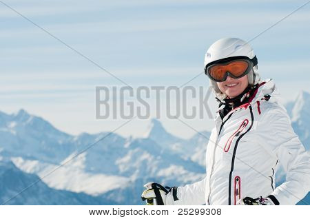 Ski vacation - female skier on ski slope in Swiss Alps
