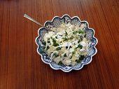 stock photo of raita  - Yogurt cucumber cajik raita part of a Middle Eastern dinner   - JPG