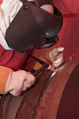 stock photo of hse  - Argon welder is working on pipe connection - JPG