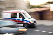 Ambulance In Motion Driving Down The Road poster