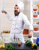 Angry Bearded Chef Throws Knife. Vegetarian Concept. Cooking. Professional Chef In Uniform. Healthy  poster