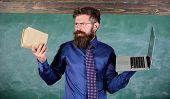 Teacher Bearded Hipster Holds Book And Laptop. Choose Right Teaching Method. Teacher Choosing Modern poster
