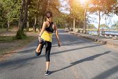Young Fitness Woman Runner Stretching Legs Before Run On City, Young Fitness Sport Woman Running On  poster