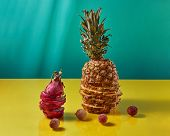 The composition with tropical exotic fruit single pineapple and dragon fruit, pitaya made up of slic poster