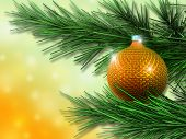 image of christmas ornament  - Colorful Christmas ornament hanging from a xmas tree branch - JPG