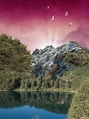 picture of fantasy landscape  - The landscape of the surrounded lake of forest and mountains in a luminous day - JPG