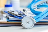 Stethoscope Lying On Medical Form On Clipboard . poster