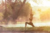 Healthy Lifestyle.  Silhouette Meditation Yoga Woman For Relax Vital And Energy In The Morning At Th poster