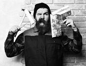 Spatulas With Satisfied Face On Brick Wall Studio Background, Bearded Painter Man Holding Various Bu poster