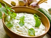picture of raita  - A bowl of tzatziki and fresh ingredients - JPG