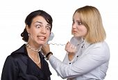stock photo of strangled  - Business woman with telephone wire strangling another woman isolated on white background - JPG