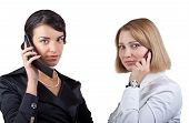 image of people talking phone  - Two business women talking on mobile phone isolated on white background - JPG