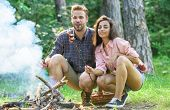 Couple Roasting Sausages On Sticks Nature Background. Couple In Love Enjoy Camping Forest Roasting S poster