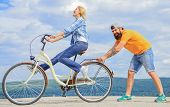 Learn Cycling With Support. Cycling Technique. Woman Rides Bicycle Sky Background. How To Learn To R poster