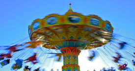 foto of carnival ride  - Circus ride on a brightly colored carousel - JPG