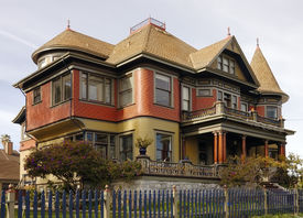 picture of victorian houses  - A large Victorian home with a lot of filigree and gingerbread on the facade - JPG
