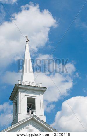 New England Church Steeple Against Cloudy Blue Sky