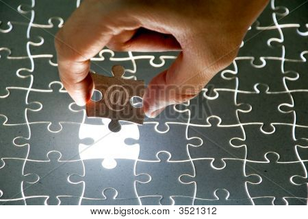 Holding A Puzzle Piece 5