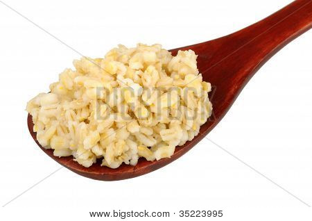 Cooked Pearl Barley In A Wooden Spoon